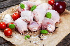 Raw Chicken Drumsticks with basil and pepper, salt, vegetables.  Stock Images