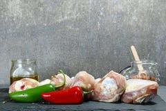 Raw chicken drumsticks Stock Images