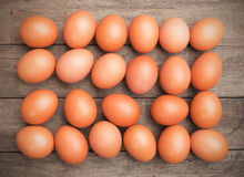 Raw chicken eggs. On dark wooden board Stock Photography