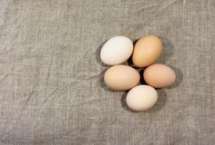 Raw chicken eggs. On linen texture. background royalty free stock photo