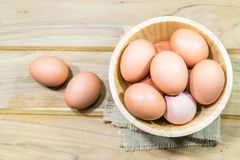 Raw chicken eggs. In wooden bowl Royalty Free Stock Photos