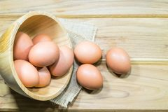 Raw chicken eggs. In wooden bowl Stock Image