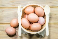 Raw chicken eggs. In wooden bowl Royalty Free Stock Photo