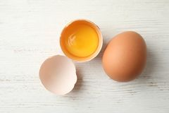 Raw chicken eggs on wooden background. Top view royalty free stock photos