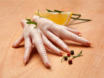 Raw chicken feet with lemon Royalty Free Stock Photos