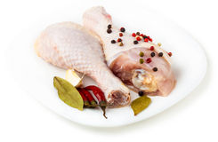 Raw chicken feet on the plate with spices. White background Royalty Free Stock Photos