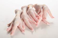 Raw chicken feet on a white table. Fresh chicken feet on a white table Stock Images