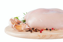 Raw chicken fillet on board Stock Image