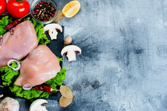 Raw chicken fillet on cutting board with spices and herbs. Stock Image