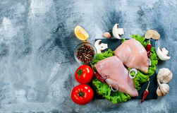 Raw chicken fillet on cutting board with spices and herbs. Food background. Cooking ingredients. Fresh meat.Top view. Copy space Royalty Free Stock Photography
