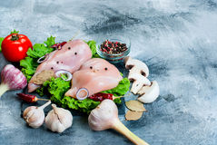 Raw chicken fillet on cutting board with spices and herbs. Food background. Cooking ingredients. Fresh meat.Top view. Copy space Royalty Free Stock Photo
