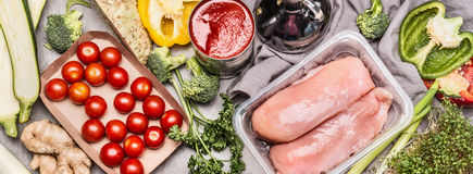 Raw Chicken fillet in plastic box with vegetables selection for Healthy diet cooking, top view. Banner Stock Image