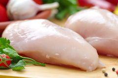 Raw chicken fillet prepared for cooking. Raw chicken fillet with vegetables prepared for cooking Stock Photo