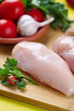 Raw chicken fillet prepared for cooking. Raw chicken fillet with vegetables prepared for cooking Royalty Free Stock Photos