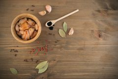 Raw Chicken Fillet. Raw Chicken Breast with Soy Souse in Wood Bowl. Fresh Turkey Fillet Chunks on Wooden Background Top View Royalty Free Stock Photo
