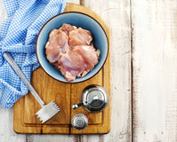 Raw chicken fillet. Salt and pepper on wooden cooking board Royalty Free Stock Photography