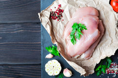 Raw chicken fillet. With spices and herbs on stone slate background Stock Photo