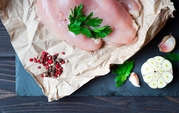 Raw chicken fillet. With spices and herbs on stone slate background Stock Photography