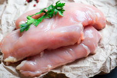 Raw chicken fillet. With spices and herbs on stone slate background Royalty Free Stock Images