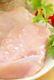 Raw chicken fillet with spices and vegetables. On the plate Stock Images