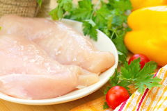 Raw chicken fillet with spices and vegetables Stock Photos