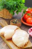 Raw chicken fillet with spices and vegetables. Ready for cooking Stock Photos
