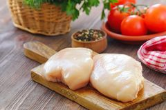 Raw chicken fillet with spices and vegetables. Ready for cooking Stock Photography