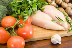 Raw chicken fillets and vegetables Stock Photo