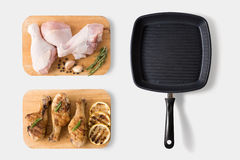 Raw chicken and grilled chicken on cutting board with grill pan Royalty Free Stock Image