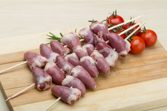Raw chicken hearts for barbecue. Raw chicken hearts ready for barbecue with rosemary Royalty Free Stock Photography