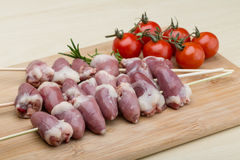 Raw chicken hearts for barbecue. Raw chicken hearts ready for barbecue with rosemary Royalty Free Stock Photo