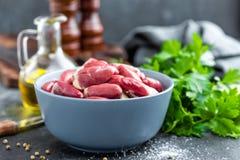 Raw chicken hearts. Closeup, stock photo Stock Image