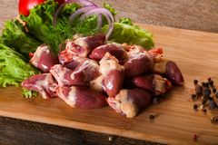 Raw chicken hearts. For cooking Stock Photos