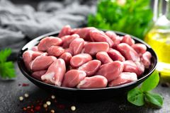 Raw chicken hearts. Fresh chicken hearts. In bowl Royalty Free Stock Images