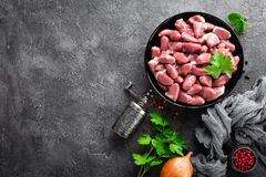 Raw chicken hearts. Fresh chicken hearts. In bowl Royalty Free Stock Photo