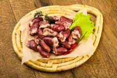 Raw chicken hearts. Heap with thyme branch Stock Image
