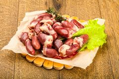 Raw chicken hearts. Heap with thyme branch Stock Images