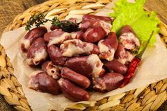 Raw chicken hearts. Heap with thyme branch Royalty Free Stock Photography