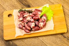 Raw chicken hearts. Heap with thyme branch Royalty Free Stock Photos
