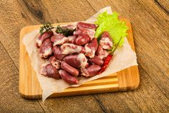 Raw chicken hearts. Heap with thyme branch Royalty Free Stock Images
