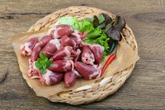 Raw chicken hearts. On the plate ready for cooking Stock Photography