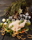 Raw chicken with herbs spices ingredients, ready for Christmas. On a wooden table, selective focus Royalty Free Stock Image
