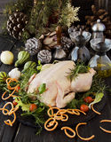 Raw chicken with herbs spices ingredients, ready for Christmas. On a wooden table, selective focus Stock Photos