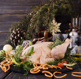 Raw chicken with herbs spices ingredients, ready for Christmas. On a wooden table, selective focus Stock Image