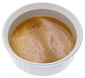 Raw Chicken In Lemon Pepper Flavored Marinade Stock Photography