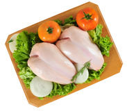 Raw chicken. Isolated. Chicken breast with vegetables on cutting board Royalty Free Stock Image
