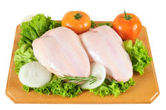 Raw chicken. Isolated. Chicken breast with vegetables on cutting board Royalty Free Stock Photo