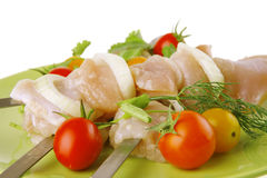 Raw chicken kebabs Stock Images