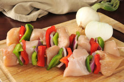 Raw chicken kebabs Royalty Free Stock Images