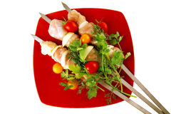 Raw chicken kebabs on red Stock Photo